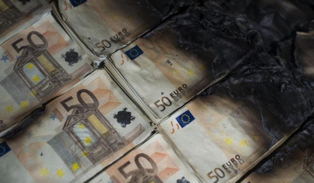 50 Euro Notes Get Scorched to Make This Table